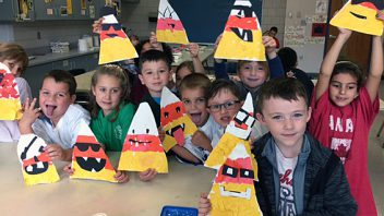 Arongen first graders in Ms. Foster's art class prepare for Halloween by creating fun and festive collage candy corns.