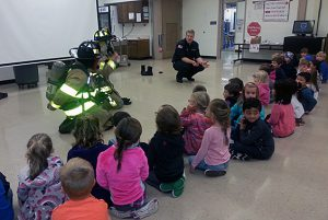 Round Lake Fire Department provides safety lessons at Chango. Run to the Fire Fighter---don't run away.