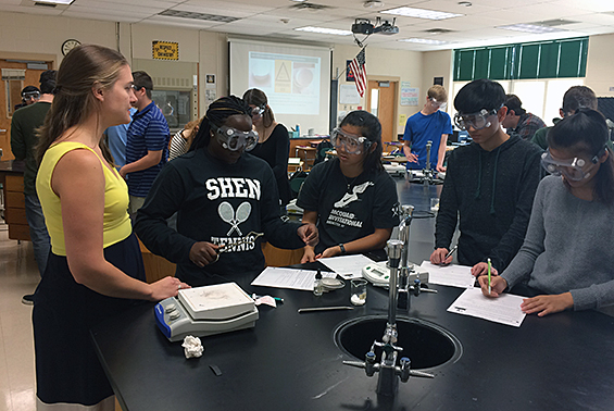 AP Chemistry class. Students work on lab for collection of data to support the concepts of mole ratios.