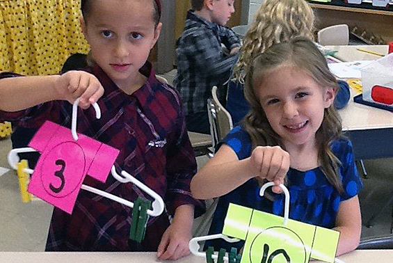 """Orenda first graders practice sums of ten using """"clothesline t-shirts."""""""