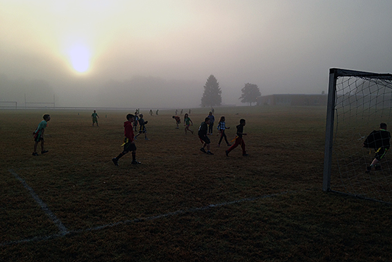Skano students enjoy some early morning fun in the fog.