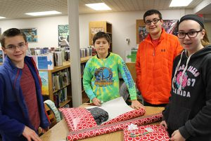 Today the Acadia Student Council met in the Acadia Library to wrap gifts for an Acadia family.