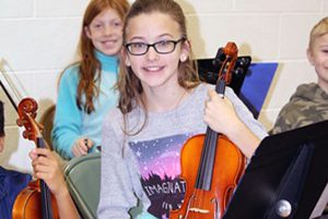 Chango 5th grade orchestra students perform at the in-school winter concert.