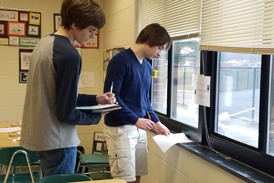 High School students in the Senior Calculus Course were sent on a treasure hunt, working in stations calculating derivatives of trig functions using the chain rule.