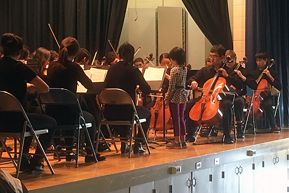 "The High School Chamber Orchestra played for the Karigon morning program. A Karigon student served as the ""guest conductor."""