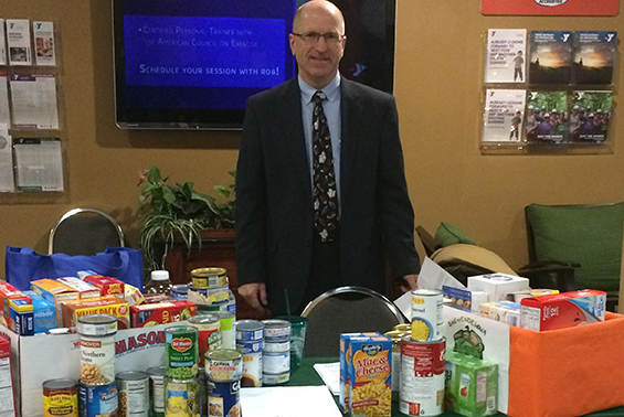 High School Principal Don Flynt volunteered his time in the early hours at the Southern Saratoga YMCA for Giving Tuesday collecting items for the high school food pantry.