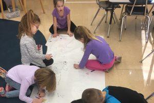 Karigon & Orenda EDK students have fun practicing writing.