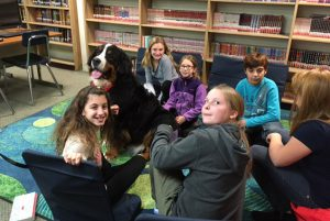 Koda GOALS club (Get Organized and Learn) had therapy dogs visit.