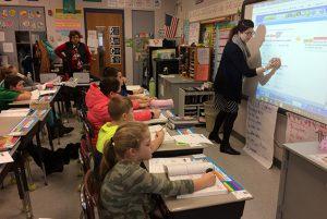 Arongen teacher Amanda Larkin uses chromebooksto enhance the math lesson.