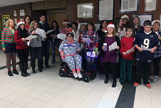 Gowana staff and students welcome students to the building with their caroling.
