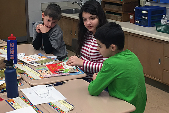 Orenda second graders sharing time with their Book Buddies from Koda Middle School.