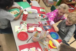 Karigon & Orenda EDK students recycle holiday cards.  EDK Students took old holiday cards and recycled them into new ones to give to special people.