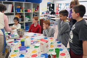 Tesago students in Mrs. Wander-Eyer's classroom make cookies for the holidays.