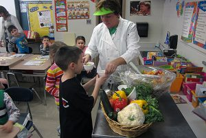 The Cook Manager at Skano/Tesago teaches Mrs. Gerstenberger's 2nd grade class at Tesago about good nutrition and had them try new fruits and vegetables!