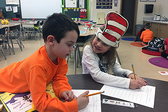 Tesago first graders in Mrs. Kern's room celebrate Dr. Seuss's birthday with a variety of events, including a scavenger hunt and writing a thank you note for their 100 books!