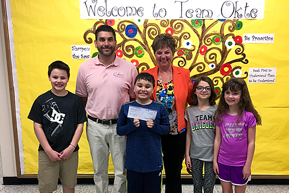 Okte receives $500 from Mobil Exxon to purchase items for math and/or science.