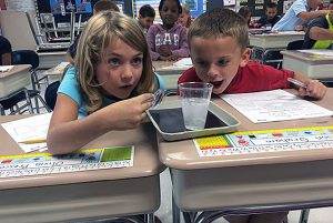 Mrs. Pembrook's 2nd graders experimenting with Solids, Liquids and Gasses