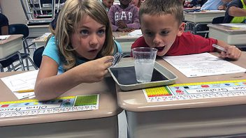 Mrs. Pembrook's 2nd graders experimenting with solids, liquids and gases.