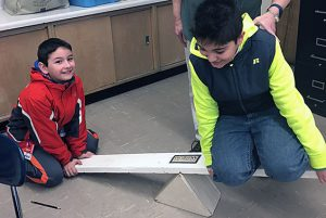 Skano fourth graders learn about simple machines during a CMOST presentation.