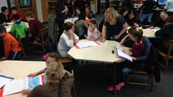 Parents of children in Mrs. Catallo's second grade class surprise students at their book publishing party at Tesago. More photos…