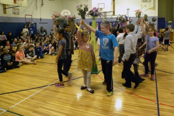 Okte celebrated May Day! Each grade level had a special song and dance to perform. Mrs. Bailey, the official May Queen, kept the festivities moving along