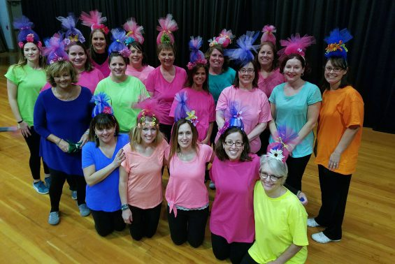 Okte staff performed as Trolls for the Okte Variety Show and raised over $2300 for their new playground!