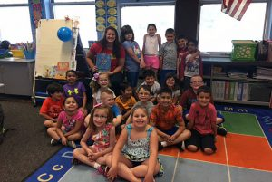 Arongen first graders in Ms. Baker's class were lucky to have the National Champion in Hammer Throw, Jill Shippee, visit their classroom to read The Rainbow Fish!