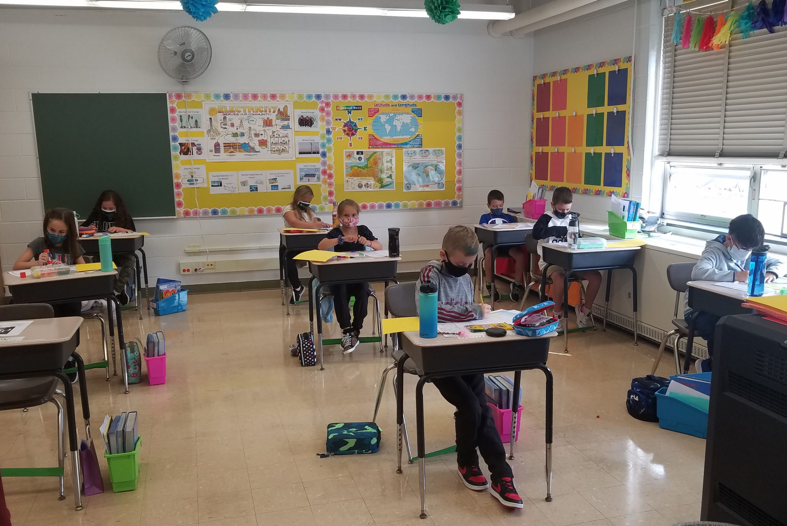 Students sitting at desks in class