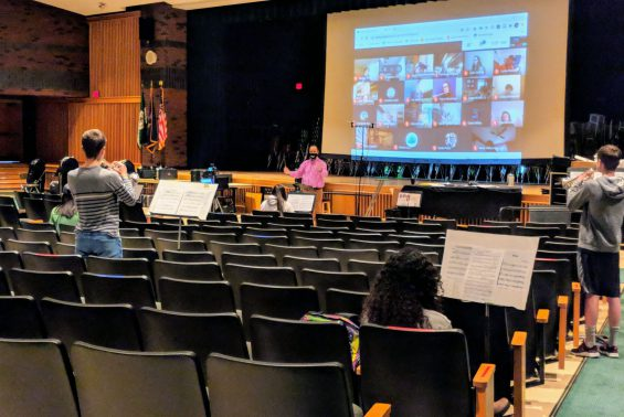 students playing instruments in auditorium