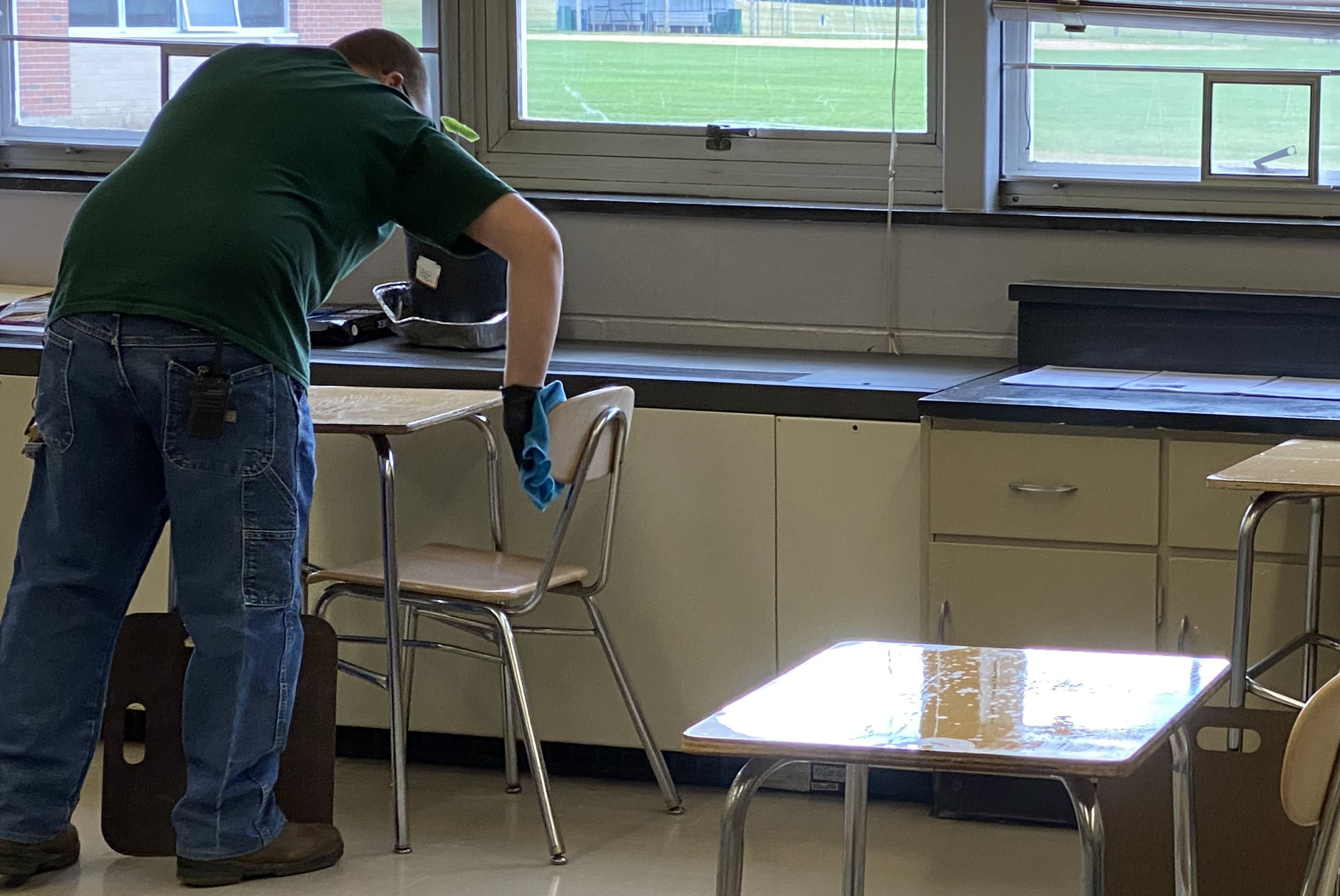 staff cleaning a classroom