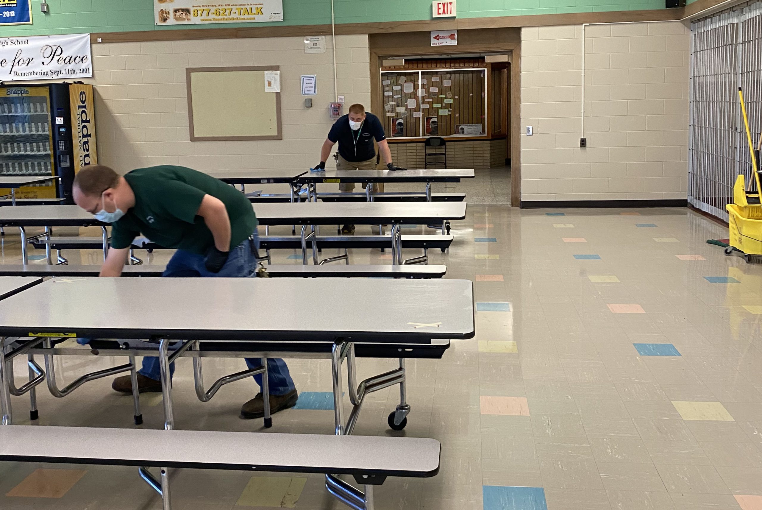 staff cleaning the cafeteria