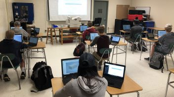 Terry Nagy's high school CIM class working on solid modeling design problems on laptops that are part of the state of the art technology wing that is still under construction.