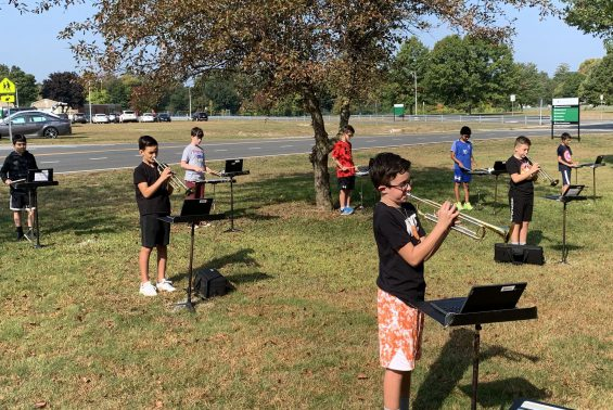 Band students playing instruments outside