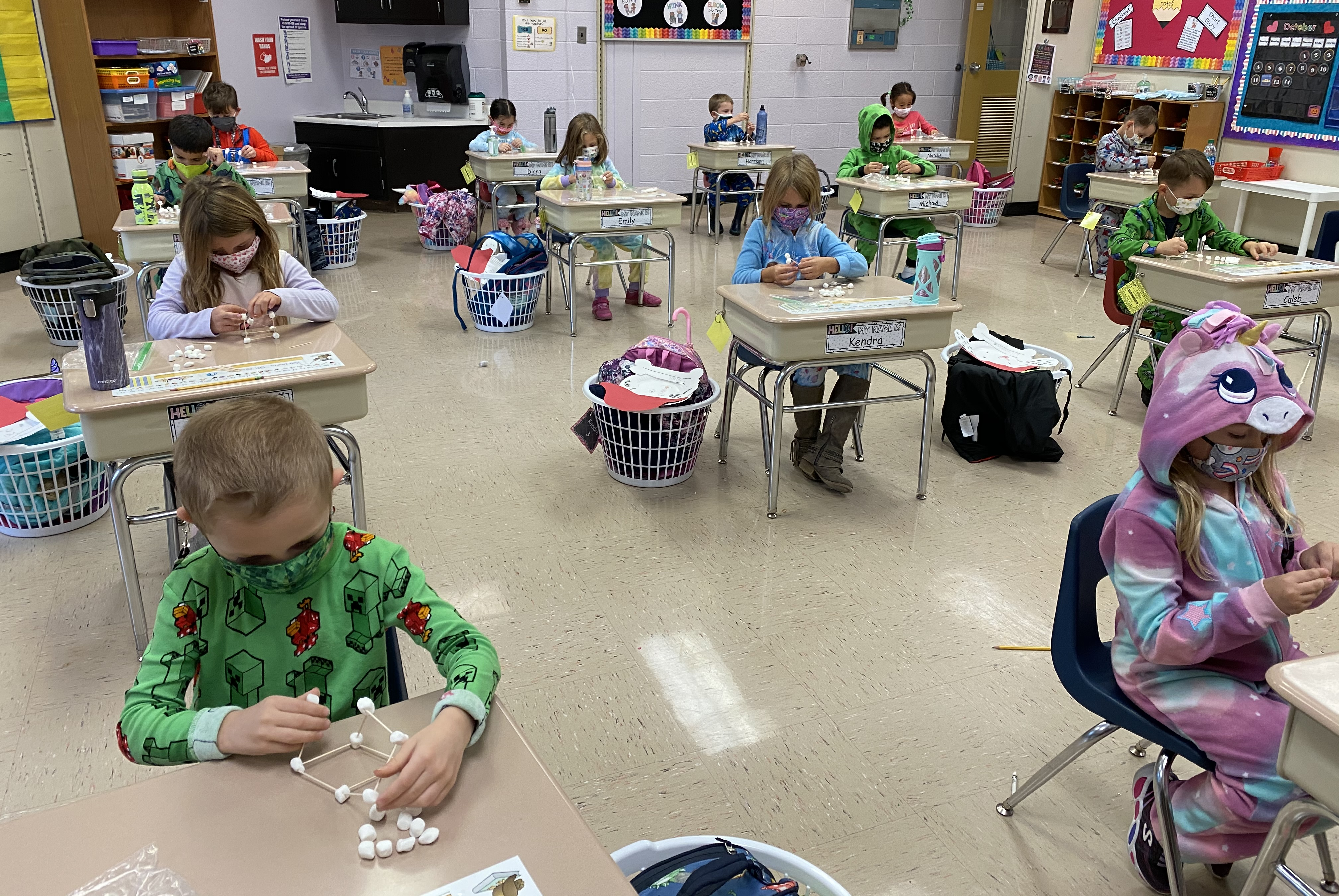 Mrs. Girard's first grade class at Okte has a pajama day and utilizes engineering skills after listening to a story to build a pumpkin tower for the farmer using toothpicks and marshmallows.