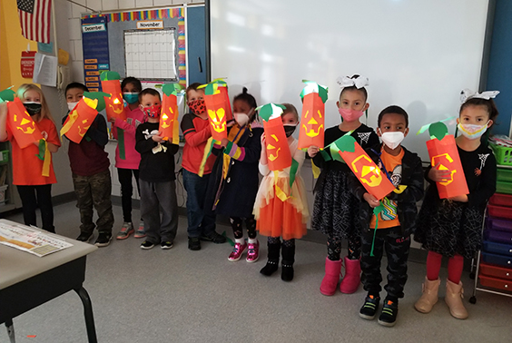 Students with pumpkin masks