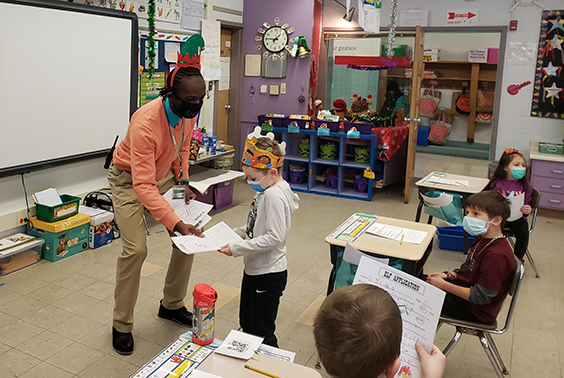 Principal Mr. Jones gave the Elf Oath to Mrs. L'Amoureux's first-grade class at Karigon.