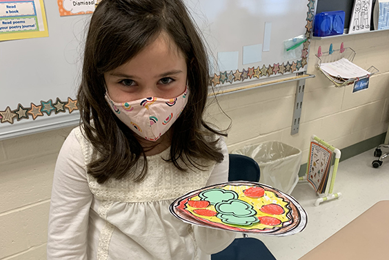 Mrs. Russell's first graders make pizza during their How-to- writing unit.