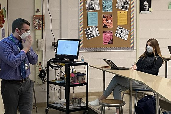 High School Social studies teacher Andrew Companion leads a discussion about Queen Victoria, using lyrics from a song contextualizing the history of the Industrial Revolution. The content was made more interesting by having the students become detectives of history.