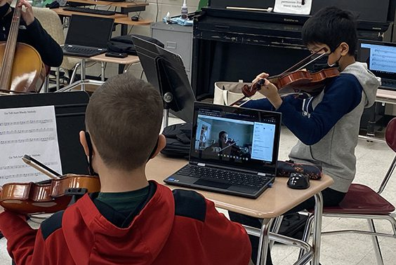 Nicole Fountain's strings music class at Gowana keeps students' focus and attention to detail, both in-person and CVL (using Break-out Rooms).
