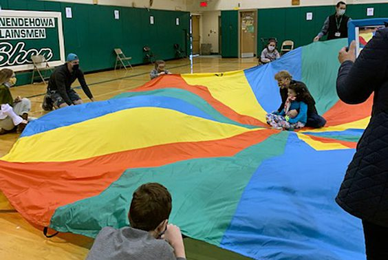 John Coletta's Life Skills/Move Program PE class at High School West having fun with the parachute.