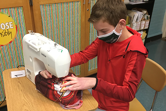 Students in Emily Litwin's seventh grade FACS class sew reusable shopping bags and face masks giving new life to previously worn garments as part of the sustainability/clothing management unit.