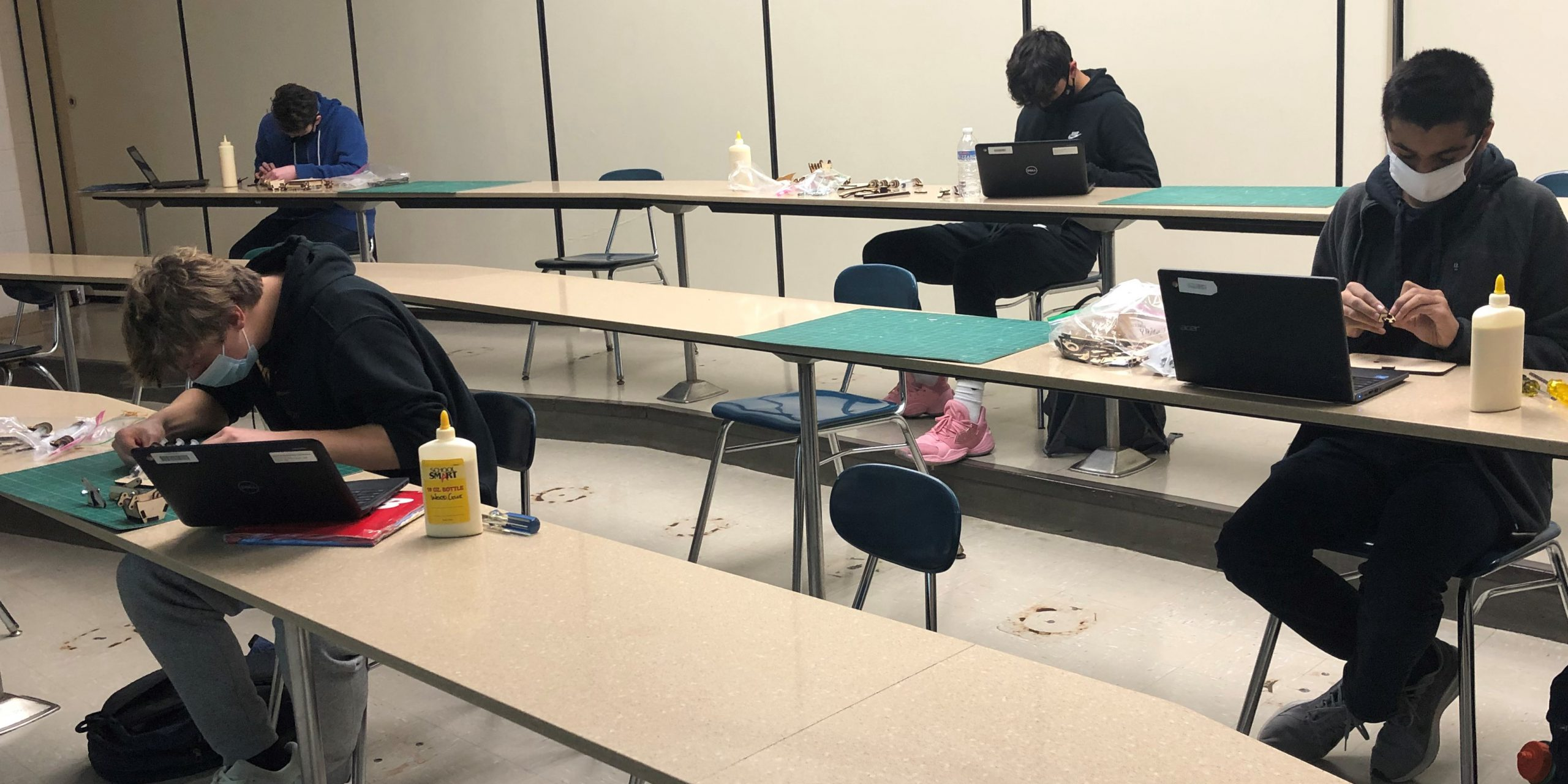 Students in Mr. Dillman's Principles of Engineering Class build model steam shovels, applying principles learned during the hydraulics unit.