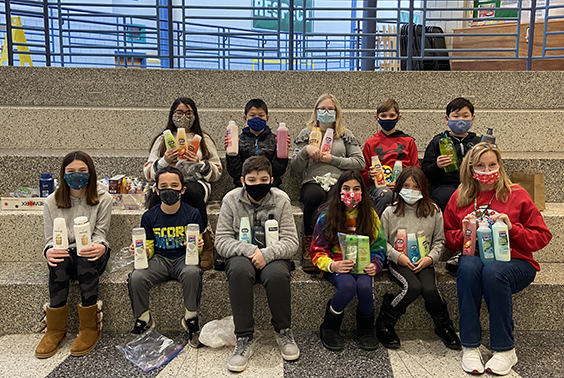 """Members of Mrs. Renzi's 5th grade class at Arongen show their contributions for Captain during our annual """"Giving Tree""""."""