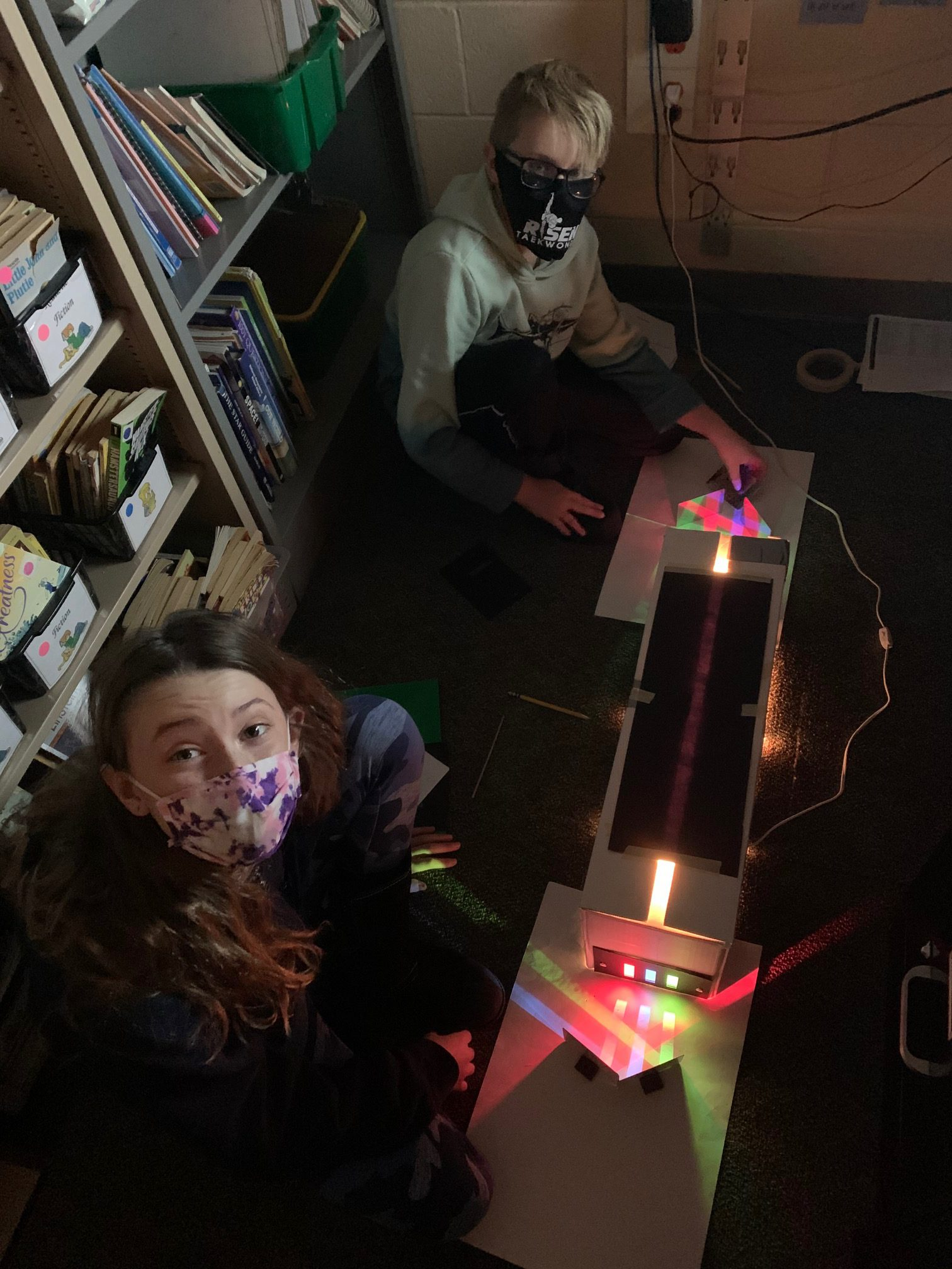 Students using machine to learn about light