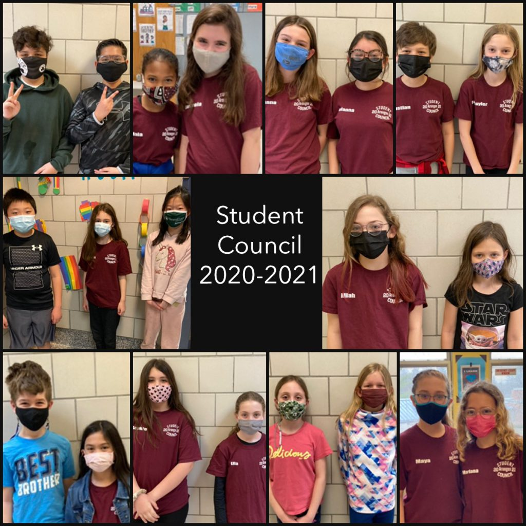 students posing with masks