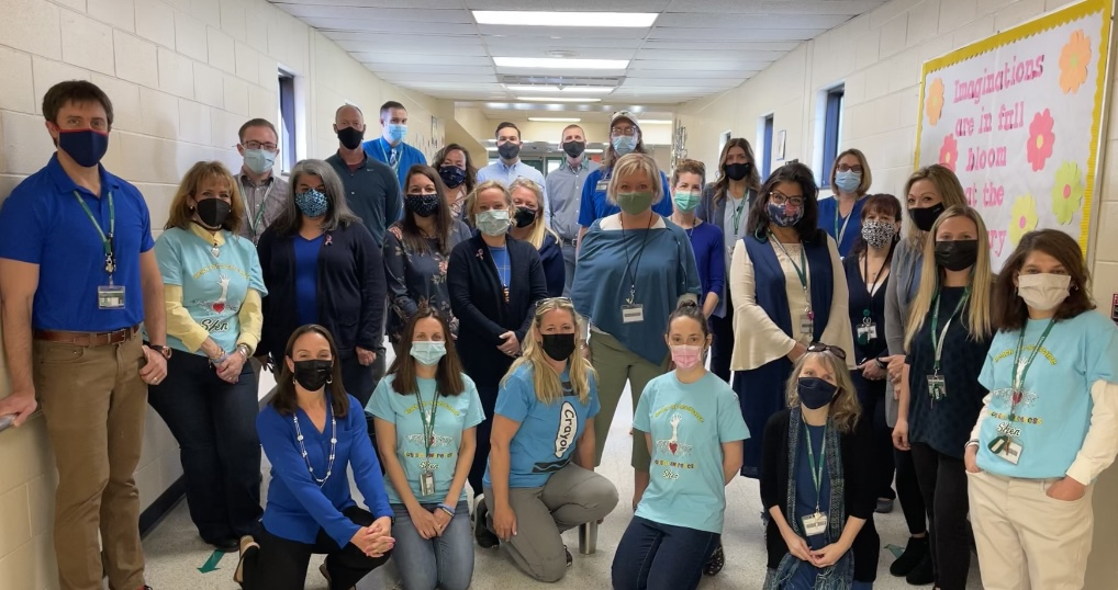 Koda staff wears blue and some students researched well known people and historical figures who have Autism and created a display for Autism Awareness Month.