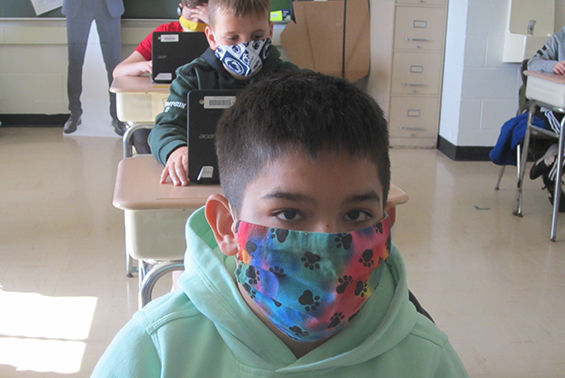 student wearing a silly mask