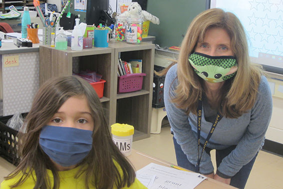 teacher  and student wearing a silly mask