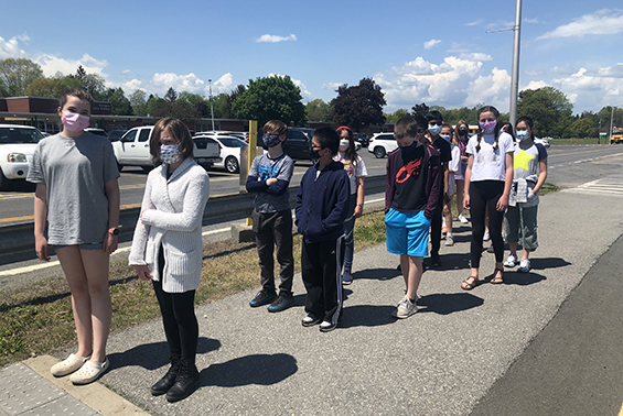 """Mrs. Smith's Middle School Critical Inquiry students make the most of the internet being down with - a """"walk and talk"""" planning their Expert/Inspire speeches."""