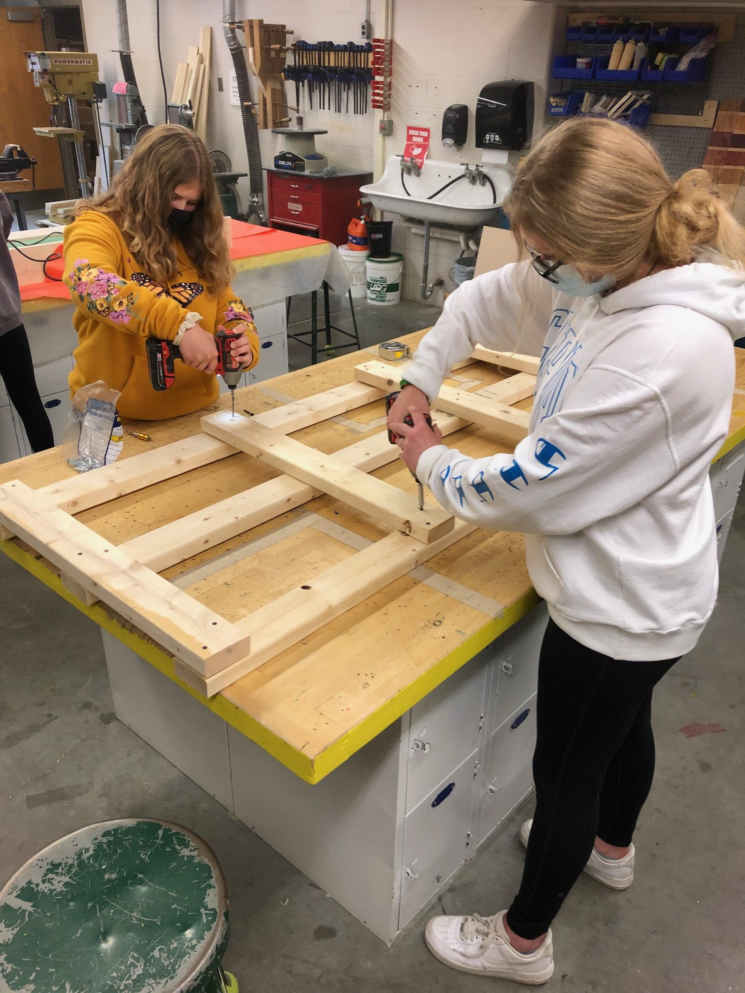 Tech students working on the cow base